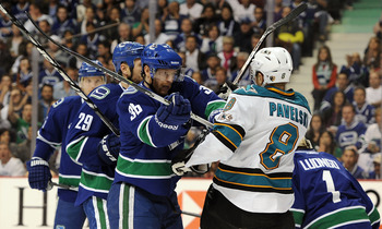 VANCOUVER, CANADA - MAY 18:  Jannik Hansen #36 of the Vancouver Canucks pushes Joe Pavelski #8 of the San Jose Sharks in the crease area after the whistle in the first in Game Two of the Western Conference Finals during the 2011 Stanley Cup Playoffs at Ro
