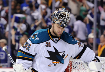 VANCOUVER, CANADA - MAY 18: Goaltender Scott Nichol #21 of the San Jose Sharks looks on after being scored on by Kevin Bieksa #3 of the Vancouver Canucks (not in photo) in the second period in Game Two of the Western Conference Finals during the 2011 Stan