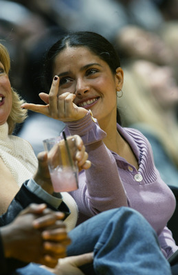 LOS ANGELES - NOVEMBER 22:  Film actress Salma Hayek sits courtside during the NBA game between the Chicago Bulls and the Los Angeles Lakers at Staples Center on November 22, 2002 in Los Angeles, California.  The Lakers won 86-73.  NOTE TO USER: User expr