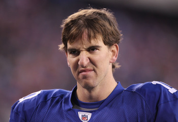 EAST RUTHERFORD, NJ - DECEMBER 19:  Eli Manning #10 of the New York Giants walks off the field dejected after losing to the Philadelphia Eagles 38-31  on December 19, 2010 at The New Meadowlands Stadium in East Rutherford, New Jersey.  (Photo by Al Bello/