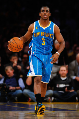 LOS ANGELES, CA - APRIL 20:  Chris Paul #3 of the New Orleans Hornets moves the ball while taking on the Los Angeles Lakers in Game Two of the Western Conference Quarterfinals in the 2011 NBA Playoffs on April 20, 2011 at Staples Center in Los Angeles, Ca