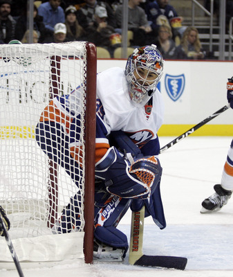 PITTSBURGH, PA - FEBRUARY 02:  Rick DiPietro #39 of the New York Islanders eyes the puck in the corner against the Pittsburgh Penguins at Consol Energy Center on February 2, 2011 in Pittsburgh, Pennsylvania.  (Photo by Justin K. Aller/Getty Images)
