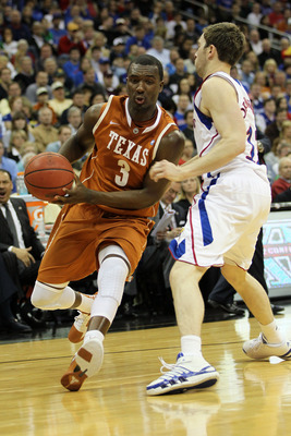 KANSAS CITY, MO - MARCH 12:  Jordan Hamilton #3 of the Texas Longhorns drives with the ball against Brady Morningstar #12 of the Kansas Jayhawks during the 2011 Phillips 66 Big 12 Men's Basketball Tournament championship game at Sprint Center on March 12,