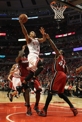 CHICAGO, IL - MAY 18:  Derrick Rose #1 of the Chicago Bulls drives for a shot attempt against Udonis Haslem #40 of the Miami Heat in Game Two of the Eastern Conference Finals during the 2011 NBA Playoffs on May 18, 2011 at the United Center in Chicago, Il