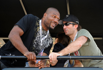 CONCORD, NC - MAY 30:  Actors Sharlto Copley (R) and Quinton 'Rampage' Jackson talk in the #39 U.S. Army Chevrolet pit box prior to the NASCAR Sprint Cup Series Coca-Cola 600 at Charlotte Motor Speedway on May 30, 2010 in Concord, North Carolina.  (Photo