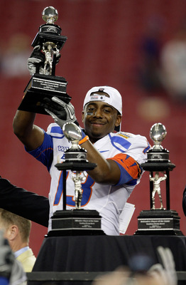 GLENDALE, AZ - JANUARY 04:  Brandyn Thompson #13 of the Boise State Broncos celebrates with the defensive MVP trophy after defeating the TCU Horned Frogs 17-10 during the Tostitos Fiesta Bowl at the Universtity of Phoenix Stadium on January 4, 2010 in Gle
