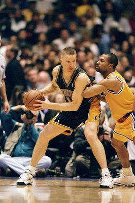 14 Feb 1999: Chris Mullin #17 of the Indiana Pacers controls the ball as Derek Fisher #2 of the Los Angeles Lakers tries to block at the Great Western Forum in Inglewood, California. The Pacers defeated the Lakers 101- 99.  Mandatory Credit: Donald Mirall