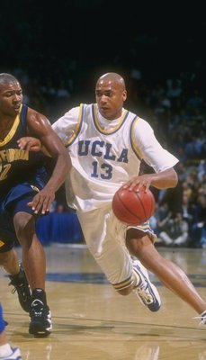 6 Feb 1997:  Guard Charles O''Bannon of the UCLA Bruins (right) moves the ball as California Bears guard Ed Gray covers him during a game at Pauley Pavilion in Los Angeles, California.  California won the game, 71-68. Mandatory Credit: David Taylor  /Alls