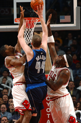 CHICAGO - JANUARY 23:  Forward Antonio Davis #34 and center Eddy Curry #2 of the Chicago Bulls pressure center Shawn Bradley #44 of the Dallas Mavericks as he shoots during a game on January 23, 2004 at the United Center in Chicago, Illinois. The Maverick