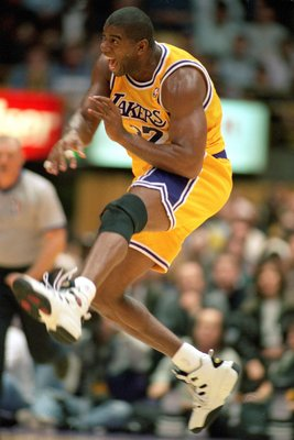 30 Jan 1996: Magic Johnson #32 of the Los Angeles Lakers celebrates on the court during his first game back as a Laker at the Great Western Forum in Inglewood, California.   Mandatory Credit: Allsport  /Allsport