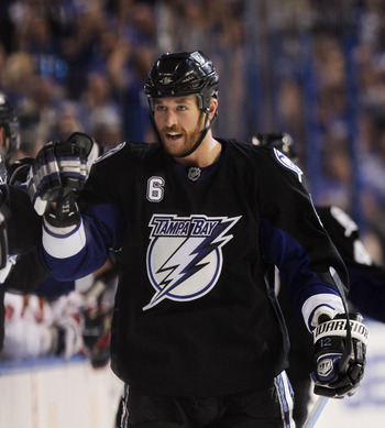 TAMPA, FL - MAY 03:  Ryan Malone #6 of the Tampa Bay Lightning returns to the bench following his game winning goal at 5:47 of the third period against the Washington Capitals in Game Three of the Eastern Conference Semifinals during the 2011 NHL Stanley