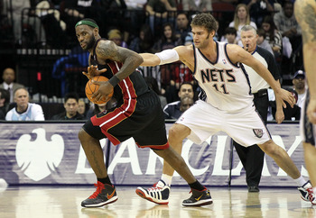 NEWARK, NJ - APRIL 03:  LeBron James #6 of the Miami Heat steals the ball from Brook Lopez #11 of the New Jersey Nets at the Prudential Center on April 3, 2011 in Newark, New Jersey.The Heat defeated the Nets 108-94.NOTE TO USER: User expressly acknowledg