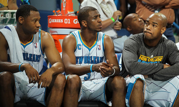 NEW ORLEANS, LA - APRIL 28:  (L-R) Willie Green #33, Chris Paul #3 and Jarrett Jack #2 of the New Orleans Hornets react on the bench during a 98-80 loss against the Los Angeles Lakers in Game Six of the Western Conference Quarterfinals in the 2011 NBA Pla