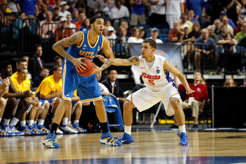 TAMPA, FL - MARCH 19:  Tyler Honeycutt #23 of the UCLA Bruins looks to pass against Scottie Wilbekin #5 of the Florida Gators during the third round of the 2011 NCAA men's basketball tournament at St. Pete Times Forum on March 19, 2011 in Tampa, Florida.