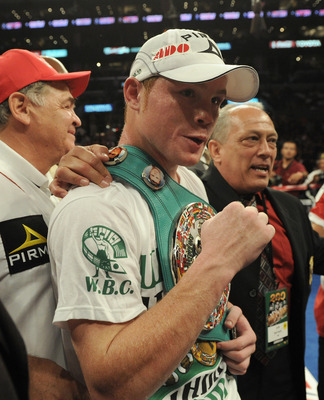 LOS ANGELES, CA - SEPTEMBER 18:  Saul Alvarez of Mexico celebrates his knockout of Carlos Baldomir of Argentina during the sixth round in the WBC Super Welterweight Silver Title fight at Staples Center on September 18, 2010 in Los Angeles, California.  (P