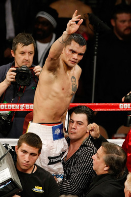 LAS VEGAS - DECEMBER 11:  Marcos Maidana of Argentina is lifted up by Sebastian Contursi after Maidana was defeated by Amir Khan of England by unanimous decision in their WBA super lightweight title fight at Mandalay Bay Events Center on December 11, 2010