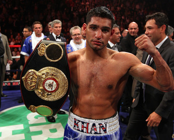 MANCHESTER, ENGLAND - APRIL 16:  Amir Khan celebrates after victory over Paul McCloskey in the WBA Light-Welterweight Championship fight between Amir Khan and Paul McCloskey at MEN Arena on April 16, 2011 in Manchester, England.  (Photo by Alex Livesey/Ge