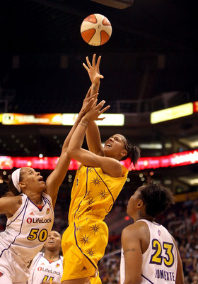 PHOENIX - SEPTEMBER 25:  Candace Parker #3 of the Los Angeles Sparks puts up a shot over Tangela Smith #50 and Cappie Pondexter #23 of the Phoenix Mercury in Game Two of the Western Conference Finals during the 2009 WNBA Playoffs at US Airways Center on A