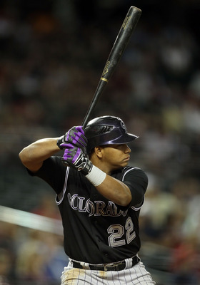 PHOENIX, AZ - MAY 03:  Jose Lopez #22 of the Colorado Rockies bats against the Arizona Diamondbacks during the Major League Baseball game at Chase Field on May 3, 2011 in Phoenix, Arizona.  The Diamondbacks defeated the Rockies 4-3.  (Photo by Christian P