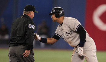 TORONTO, ON - APRIL 20:  Alex Rodriguez #13 of the New York Yankees chats with umpite Jim Joyce after being called out at second during their game against the Toronto Blue Jays at Rogers Centre on April 20, 2011 in Toronto, Canada.  (Photo by Scott Haller
