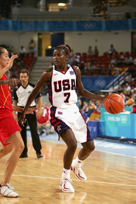 ATHENS - AUGUST 20:  Sheryl Swoopes #7 of the USA moves the ball against Spain in the women's basketball preliminary game on August 20, 2004 during the Athens 2004 Summer Olympic Games at the Indoor Arena of the Helliniko Olympic Complex in Athens, Greece