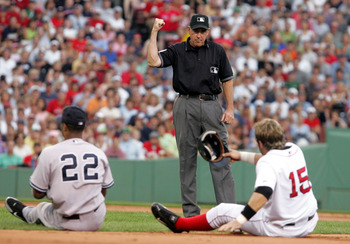 BOSTON - JULY 17:  Second base umpire Mike Winters calls out Kevin Millar #15 of the Boston Red Sox after he was tagged out in a collision with Robinson Cano #22 of the New York Yankees during thier game at Fenway Park on July 17, 2005 in Boston, Massachu