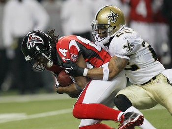 ATLANTA, GA - DECEMBER 27:  Roddy White #84 of the Atlanta Falcons fights off the tackle of Tracy Porter #22 of the New Orleans Saints during their game at the Georgia Dome on December 27, 2010 in Atlanta, Georgia.  (Photo by Kevin C. Cox/Getty Images)
