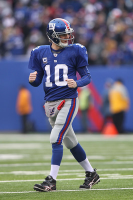 EAST RUTHERFORD, NJ - DECEMBER 19:  Eli Manning #10 of the New York Giants celebrates a touchdown by Mario Manningham during their game against the Philadelphia Eagles on December 19, 2010 at The New Meadowlands Stadium in East Rutherford, New Jersey.  (P