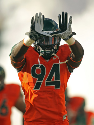 MIAMI - NOVEMBER 20: Kelvin Cain #94 of the Miami Hurricanes throws up the 'U' during a game against the Virginia Tech Hokies at Sun Life Stadium on November 20, 2010 in Miami, Florida.  (Photo by Mike Ehrmann/Getty Images)