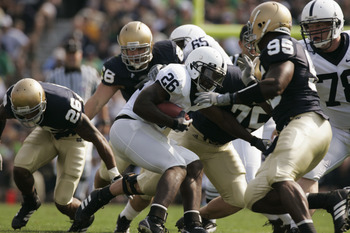 SOUTH BEND, IN - SEPTEMBER 9:  Tailback Tony Hunt #26 of the Penn State Nittany Lions runs the ball against the Notre Dame Fighting Irish defense during the game on September 9, 2006 at Notre Dame Stadium in South Bend, Indiana. (Photo By Gregory Shamus/G