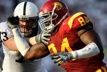 PASADENA, CA - JANUARY 01:  Defensive end Kyle Moore #84 of the USC Trojans battles for position during the 95th Rose Bowl Game presented by Citi against the Penn State Nittany Lions at the Rose Bowl on January 1, 2009 in Pasadena, California. The Trojans