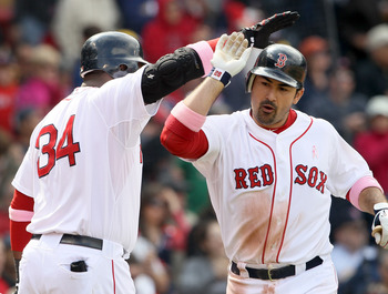 BOSTON, MA - MAY 08:  Adrian Gonzalez #28 is congratulated by teammate David Ortiz #34 of the Boston Red Sox after Gonzalez hit a solo home run in the fifth inning against the Minnesota Twins on May 8, 2011 at Fenway Park in Boston, Massachusetts.  (Photo