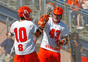 FOXBOROUGH, MA - MAY 25:  Kenny Nims #10 scores the tying goal and celebrates with Cody Jamieson #43 of the Syracuse Orange, who would later score the winning goal in overtime to defeat the Cornell Big Red, 10-9, in overtime for NCAA Division I Lacrosse C