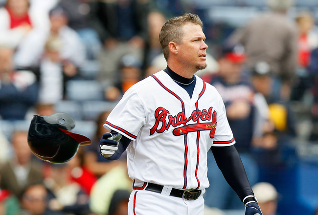 ATLANTA, GA - MAY 17:  Chipper Jones #10 of the Atlanta Braves tosses his helmet after striking out in the eighth inning against the Houston Astros at Turner Field on May 17, 2011 in Atlanta, Georgia.  (Photo by Kevin C. Cox/Getty Images)