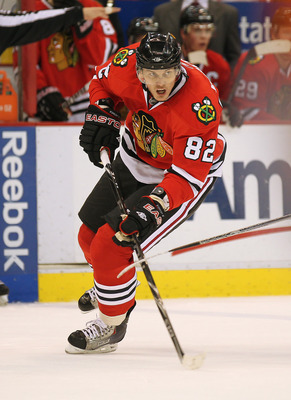 DETROIT, MI - JANUARY 22:  Tomas Kopecky #82 of the Chicago Black Hawks skates in a game against the Detroit Red Wings on January 22, 2011 at the Joe Louis Arena in Detroit, Michigan. The Hawks defeated the Wings 4-1. (Photo by Claus Andersen/Getty Images