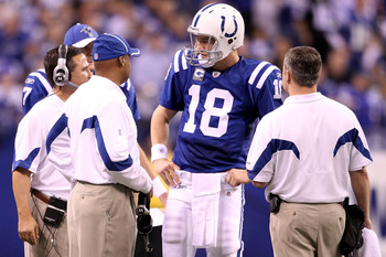 INDIANAPOLIS, IN - JANUARY 08:  Quarterback Peyton Manning #18 of the Indianapolis Colts talks with head coach Jim Caldwell against the New York Jets during their 2011 AFC wild card playoff game at Lucas Oil Stadium on January 8, 2011 in Indianapolis, Ind