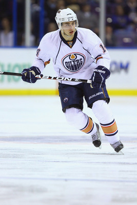 ST. LOUIS, MO - FEBRUARY 4: Jordan Eberle #14 of the Edmonton Oilers in action against the St. Louis Blues at the Scottrade Center on February 4, 2011 in St. Louis, Missouri. The Blues won 5-3. (Photo by Dilip Vishwanat/Getty Images)