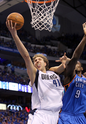 DALLAS, TX - MAY 17:  Dirk Nowitzki #41 of the Dallas Mavericks goes up for a shot in front of Serge Ibaka #9 of the Oklahoma City Thunder in the first half in Game One of the Western Conference Finals during the 2011 NBA Playoffs at American Airlines Cen