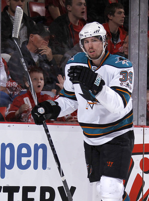 DETROIT - MAY 6: Logan Couture #39 of the San Jose Sharks celebrates a first period goal while playing the Detroit Red Wings in Game Four of the Western Conference Semifinals during the 2011 NHL Stanley Cup Playoffs on May 6, 2011 at Joe Louis Arena in De