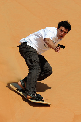 ABU DHABI, UNITED ARAB EMIRATES - FEBRUARY 05:  Taig Khris during the Laureus Sandboarding Experience as part of the 2011 Laureus World Sports Awards in the Liwa Desert, Rub Al Khali (Empty Quarter) on February 5, 2011 in Abu Dhabi, United Arab Emirates.