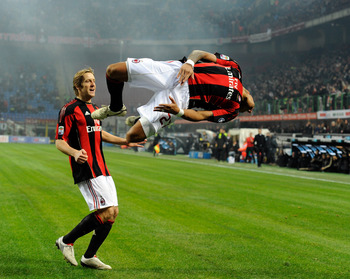 MILAN, ITALY - DECEMBER 04:  Kevin Prince Boateng of AC Milan celebrates scoring the first goal during the Serie A match between Milan and Brescia at Stadio Giuseppe Meazza on December 4, 2010 in Milan, Italy.  (Photo by Claudio Villa/Getty Images)