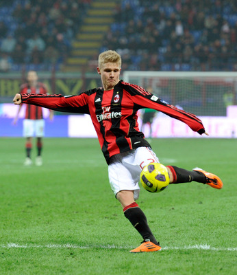 MILAN, ITALY - JANUARY 20:  Alexander Merkel of AC Milan goes for the ball during the Tim Cup match between Milan and Bari at Giuseppe Meazza Stadium on January 20, 2011 in Milan, Italy.  (Photo by Claudio Villa/Getty Images)