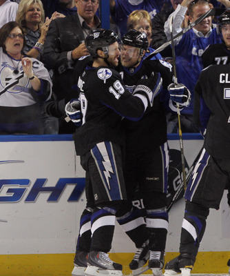 TAMPA, FL - MAY 03: Dominic Moore #19 hugs Sean Bergenheim #10 of the Tampa Bay Lightning following Bergenheim's first period goal against the Washington Capitals in Game Three of the Eastern Conference Semifinals during the 2011 NHL Stanley Cup Playoffs