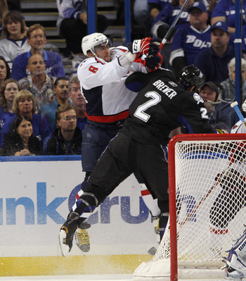 TAMPA, FL - MAY 03: Alex Ovechkin #8 of the Washington Capitals hits Eric Brewer #2 of the Tampa Bay Lightning in Game Three of the Eastern Conference Semifinals during the 2011 NHL Stanley Cup Playoffs at St Pete Times Forum on May 3, 2011 in Tampa, Flor