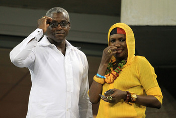 NEW YORK - SEPTEMBER 07:  (L-R) Track and Field Olympic Gold Medalist Carl Lewis and actor Grace Jones attend the men's singles match between Rafael Nadal and Feliciano Lopez of Spain during day nine of the 2010 U.S. Open at the USTA Billie Jean King Nati