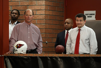 TEMPE, AZ - APRIL 29:  (2L-R) Head coach Ken Whisenhunt, general manager Rod Graves and President Michael Bidwill of the Arizona Cardinals listen to first round draft pick Patrick Peterson (not pictured) speak during a press conference to introduce him at