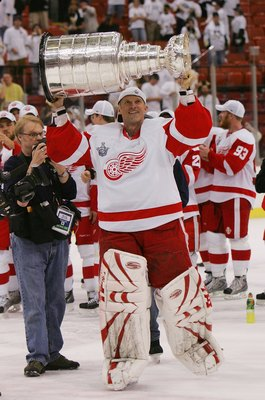 PITTSBURGH - JUNE 04: Dominik Hasek #39 of the Detroit Red Wings celebrates with the Stanley Cup after defeating the Pittsburgh Penguins in game six of the 2008 NHL Stanley Cup Finals at Mellon Arena on June 4, 2008 in Pittsburgh. Pennsylvania. The Red Wi