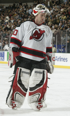DALLAS - NOVEMBER 28:  Goalie Martin Brodeur #30 of the New Jersey Devils during the game against the Dallas Stars at the American Airlines Center on November 28, 2003 in Dallas, Texas. The Stars defeated the Devils 2-0. (Photo by Ronald Martinez/Getty Im