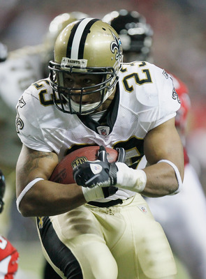ATLANTA, GA - DECEMBER 27:  Pierre Thomas #23 of the New Orleans Saints runs upfield against the Atlanta Falcons in the second half during their game at the Georgia Dome on December 27, 2010 in Atlanta, Georgia.  (Photo by Kevin C. Cox/Getty Images)