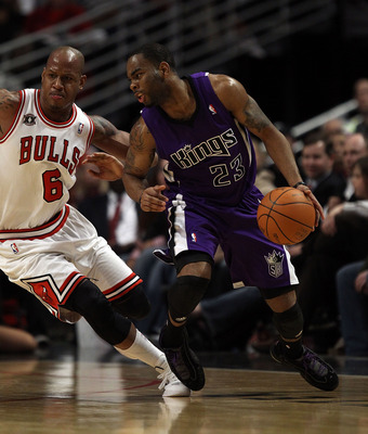 CHICAGO, IL - MARCH 21: Marcus Thornton #23 of the Sacramento Kings moves against Keith Bogans #6 of the Chicago Bulls at the United Center on March 21, 2011 in Chicago, Illinois. The Bulls defeated the Kings 132-92. NOTE TO USER: User expressly acknowled